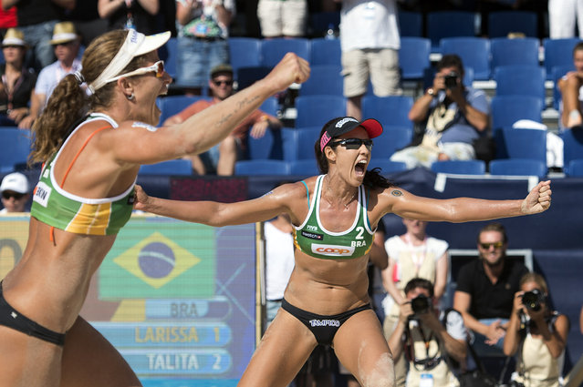 Larissa Franac, left, and Talita Antunes, of Brazil, celebrate their victory after the women's final game at the Beach Volleyball Worldtour Major Series, Saturday, July 11, 2015, in Gstaad Switzerland. (Photo by Peter Schneider/Keystone via AP Photo)