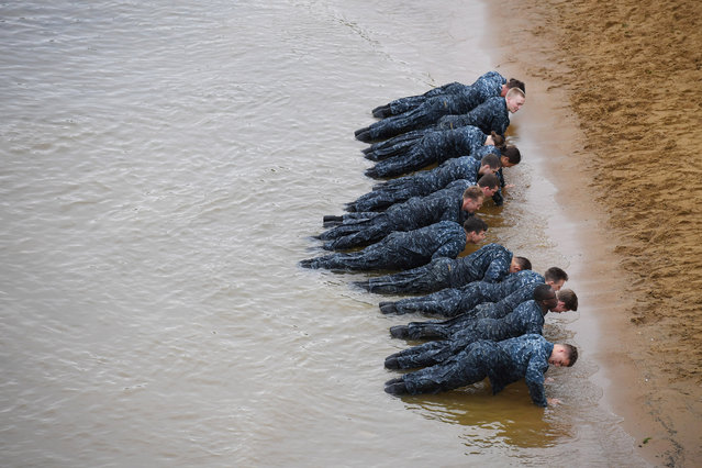 "United States Naval Academy plebes take part in the ""Wet and Sandy"" portion of Sea Trials at the United States Naval Academy on Tuesday May 17, 2016 in Annapolis, MD. (Photo by Matt McClain/The Washington Post)"
