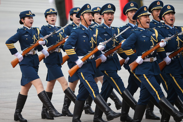 Female members of an honor guard shout as they march during a welcome ceremony for Portuguese President Anibal Cavaco Silva held by Chinese President Xi Jinping outside the Great Hall of the People on May 15, 2014 in Beijing, China. (Photo by Feng Li/Getty Images)