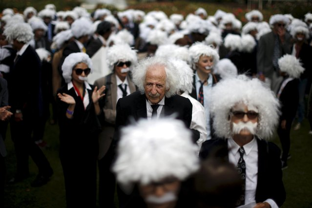Benny Wasserman, 81, (C) stands with other people dressed as Albert Einstein as they gather to establish a Guinness world record for the largest Einstein gathering, to raise money for School on Wheels and homeless children's education, in Los Angeles, California, United States, in this June 27, 2015 file photo. This picture was second most popular. (Photo by Lucy Nicholson/Reuters)