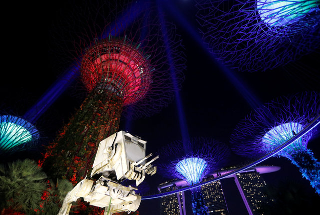 "A Star Wars AT-ST replica is displayed as Supertrees structures transform into ""lightsabers"" during activities to mark ""May the 4th"" Star Wars Day at Gardens by the Bay in Singapore May 4, 2017. (Photo by Edgar Su/Reuters)"
