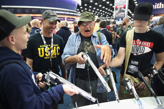 Gun enthusiasts look over Smith & Wesson pistols at the NRA Annual Meetings & Exhibits on May 21, 2016 in Louisville, Kentucky. (Photo by Scott Olson/Getty Images)