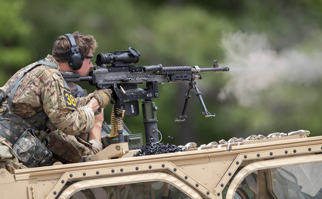 U.S. Army Sgt. Dylan Henry, of the 75th Ranger Regiment, fires a machine gun mounted on a vehicle during the Best Ranger competition Friday, April 12, 2019, in Fort Benning, Ga. (Photo by John Bazemore/AP Photo)
