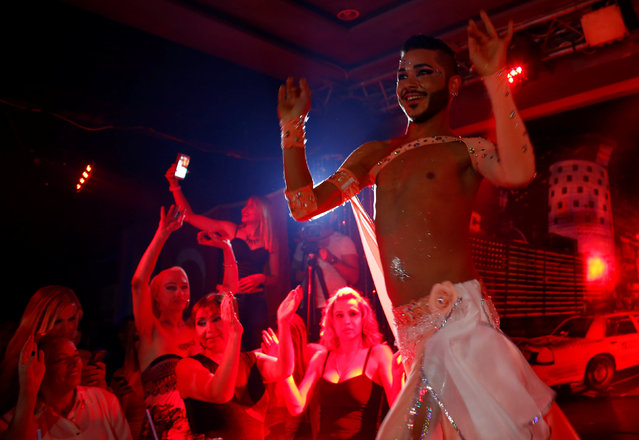 People cheer as a male belly dancer performs during the Angel of Turkey transgender/transsexual beauty pageant in Istanbul, Turkey, late May 26, 2016. (Photo by Murad Sezer/Reuters)