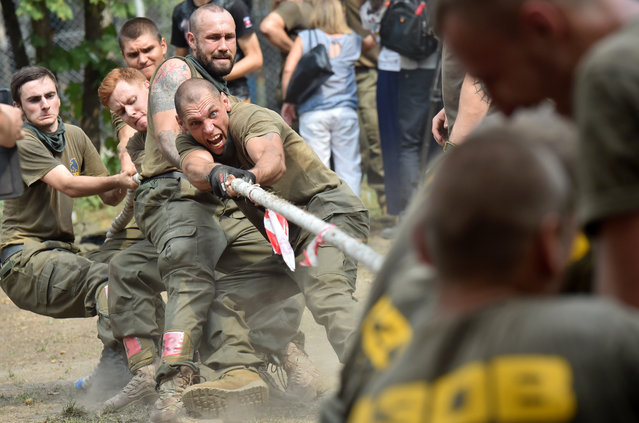Recruits to the Azov far-right Ukrainian volunteer battalion, take part in their competition in Kiev, on August 14, 2015 prior leaving to the battle fields of eastern Ukraine. (Photo by Sergei Supinsky/AFP Photo)