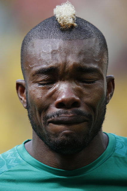 Ivory Coast's Geoffroy Serey Die cries during the playing of his national anthem before the 2014 World Cup Group C soccer match against Colombia at the Brasilia national stadium in Brasilia, June 19, 2014. (Photo by Ueslei Marcelino/Reuters)