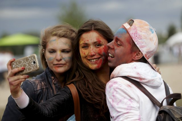 "People pose for a ""selfie"" during the Holi festival, or the Festival of Colors, in Riga, Latvia, August 1, 2015. (Photo by Ints Kalnins/Reuters)"