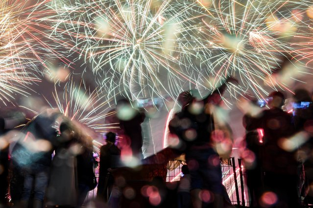 Fireworks explode over Lagoon Beach during New Year's eve celebrations at Ancol in Jakarta, Indonesia on January 1, 2020. (Photo by Muhammad Adimaja/Antara Foto via Reuters)