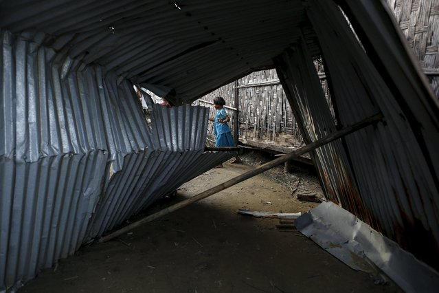 Rohingya children pass their time in a damaged shelter in Rohingya IDP camp outside Sittwe, Rakhine state on August 4, 2015. (Photo by Soe Zeya Tun/Reuters)