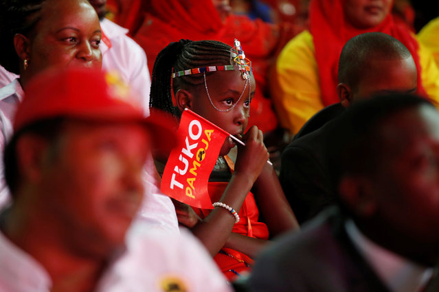 A young girl attends an event unveiling the Jubilee Party's manifesto in Nairobi, Kenya June 26, 2017. (Photo by Baz Ratner/Reuters)