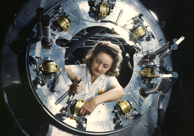 Part of the cowling for one of the motors for a B-25 bomber is assembled in the engine department of North American Aviation's Inglewood, California, plant, in October of 1942