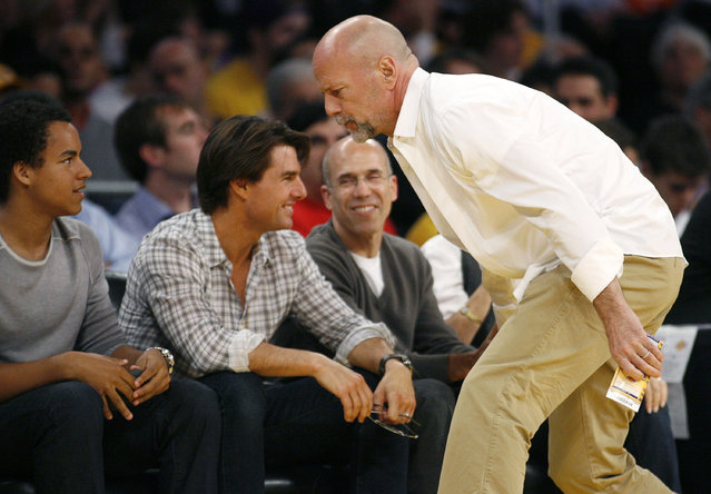 Bruce Willis walks past Tom Cruise, Connor Anthony Kidman Cruise and movie producer Jeffrey Katzenberg to get to his seat as the Lakers play the Suns in Los Angeles, May 2010. (Photo by Danny Moloshok/Reuters)