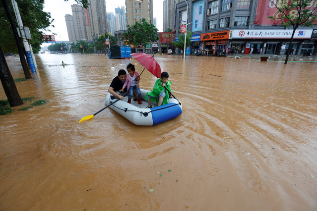 Residents make their way with an inflatable boat through a flooded area in Jiujiang, Jiangxi Province, China, June 19, 2016. (Photo by Reuters/Stringer)
