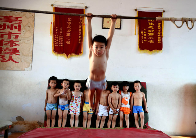 Children practice during a gymnastics summer school on July 28, 2015 in Bozhou, Anhui Province of China. (Photo by ChinaFotoPress/ChinaFotoPress via Getty Images)