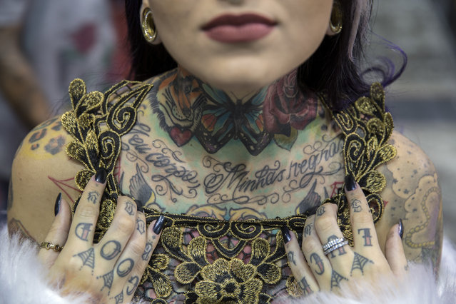 "The winner of the Miss Tattoo Brazil 2014 contest, Bruna Barros, shows a tattoo that says 'My body, my rules' during Tattoo Week, the largest convention of art in the skin of Latin America, in Sao Paulo, Brazil, 14 July 2017. A tattooed woman beauty pageant, the new trends and techniques of the tattoo world, body piercing and the environment of the art of definitively painting the body, are all due to be addressed during the seventh edition of the ""Tattoo Week Sao Paulo"". (Photo by Sebastiao Moreira/EPA)"