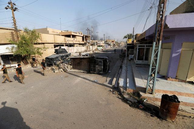 A view of a street in Falluja, Iraq, June 26, 2016. (Photo by Thaier Al-Sudani/Reuters)