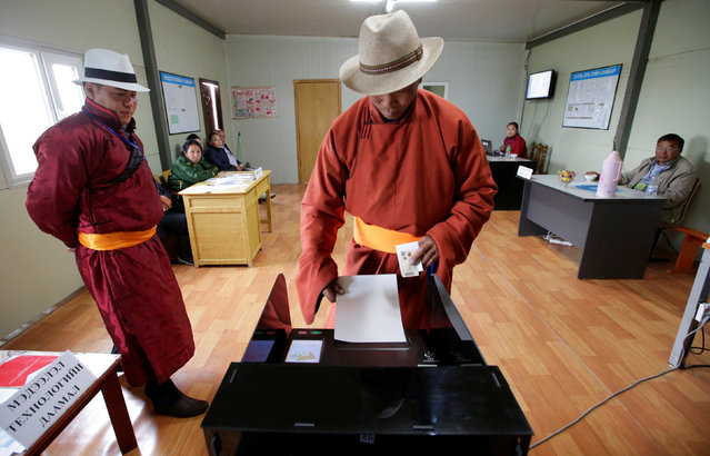 A villager votes for the parliamentary elections at a polling station on the outskirt of Ulaanbaatar, Mongolia, June 29, 2016. (Photo by Jason Lee/Reuters)