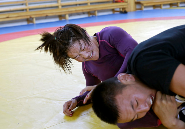 Mongolia's wrestler Sumiya Erdenechimeg (L) fights with her training partner during a daily training session at the Mongolia Women's National Wrestling Team training centre in Bayanzurkh district of Ulaanbaatar, Mongolia, July 1, 2016. (Photo by Jason Lee/Reuters)