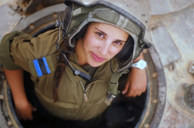 """Tank Instructor Says Hi"". A tank instructor during her training course surfaces for a second to say hello, 2012."