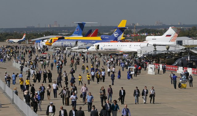 Visitors walk along a row of planes and helicopters on display at the MAKS International Aviation and Space Salon in Zhukovsky, outside Moscow, Russia, August 25, 2015. (Photo by Maxim Shemetov/Reuters)