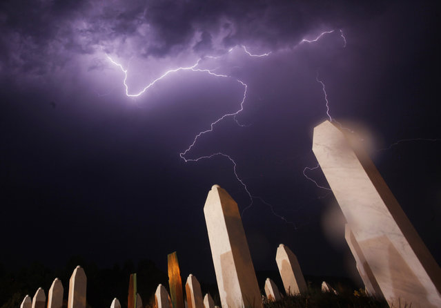 Lightning is seen during a storm under the Memorial Center in Potocari the night before a mass burial, near Srebrenica July 10, 2012. (Photo by Dado Ruvic/Reuters)