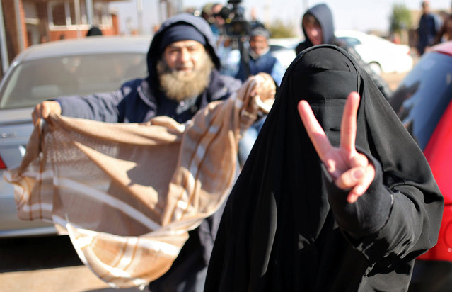 Fatima Patel (R) gestures to the photographer during her appearance with her brother, Ibrahim Mohammed Patel (not pictures) on charges they were planning attacks on the U.S. Embassy in the capital, Pretoria, as well as on buildings owned by Jewish people, at the Kagiso magistrate court,west of Johannesburg, South africa, July 18,2016. (Photo by Siphiwe Sibeko/Reuters)