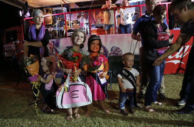 Winners of a Mr. and Ms. Dwarf competition, Adriaan Coetzee, right, Naline Kruger, first princess, center and Bernadine Coetze, left, during a weekend dwarf festival in Modimolle, South Africa, Friday, September 8, 2017. The event this past weekend drew dwarves from around the country and was an opportunity to share experiences, and discuss challenges and ways to overcome them. (Photo by Denis Farrell/AP Photo)