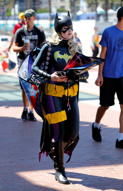 An attendee dressed as Bat Girl arrives for the start of Comic-Con International in San Diego, California, United States, July 20, 2016. (Photo by Mike Blake/Reuters)