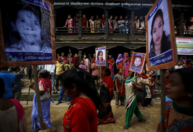 People holding portraits of their relatives who were killed in the April 25 earthquake take part in a memorial rally in Bhaktapur September 2, 2015. Twin massive earthquakes in April and May killed almost 9,000 people in Nepal's worst natural disaster. (Photo by Navesh Chitrakar/Reuters)