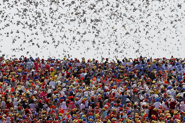 Birds are released at the end of the military parade marking the 70th anniversary of the end of World War Two, in Beijing, China, September 3, 2015. (Photo by Damir Sagolj/Reuters)