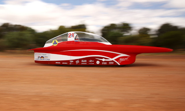 """This handout from the World Solar Challenge taken and received on October 11, 2017, shows the Solar Team Twente vehicle """"RED Shift"""" of Netherland in action near Coober Pedy on the fourth day of racing. The World Solar Challenge, an epic 3,000-kilometre (1,860-mile) solar car race across outback Australia, has become one of the world's foremost innovation challenges with teams looking to demonstrate designs that could one day lead to solar-powered cars for consumers that can carry passengers. (Photo by Mark Kolbe/AFP Photo/World Solar Challenge 2017)"""