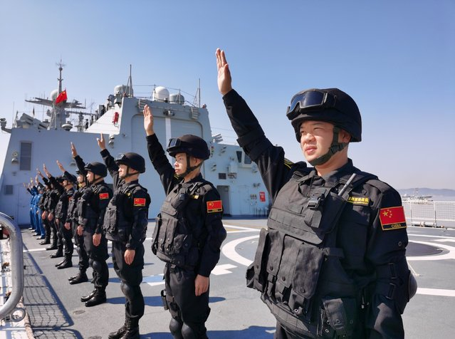Special operation soldiers of the Chinese naval fleet for escort mission wave farewell on the deck at a port in Zhoushan, east China's Zhejiang Province, April 28, 2020. The 35th fleet of the Chinese People's Liberation Army (PLA) Navy on Tuesday left the port city of Zhoushan in east China's Zhejiang Province for the Gulf of Aden and waters off Somalia to escort civilian ships. Composed of the guided-missile destroyer Taiyuan, the missile frigate Jingzhou and the supply ship Chaohu, the fleet has more than 690 officers and soldiers, dozens of special operation soldiers and two helicopters on board. (Photo by Xinhua News Agency/Rex Features/Shutterstock)