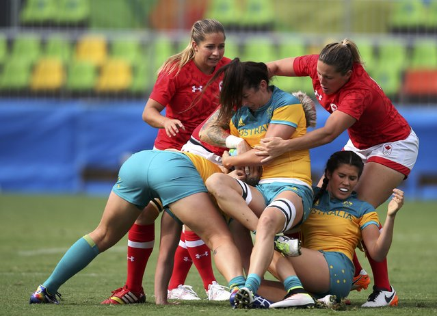2016 Rio Olympics, Rugby, Women's Semifinals Australia vs Canada, Deodoro Stadium, Rio de Janeiro, Brazil on August 8, 2016. Alicia Quirk (AUS) of Australia holds the ball in a ruck. (Photo by Alessandro Bianchi/Reuters)