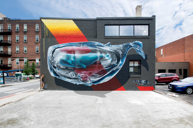 """""""Detecting machine n.1"""" mural painting for """"Wall Therapy"""" in Rochester, New York, co-curated by Urban Nation Berlin, 2015. (Photo by NeverCrew/The Huffington Post)"""