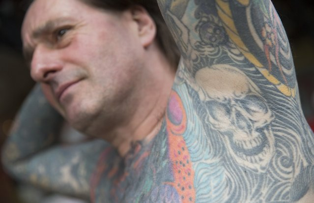 A man poses to display his tattoos during the 10th International Tattoo Convention in London September 27, 2014. (Photo by Neil Hall/Reuters)
