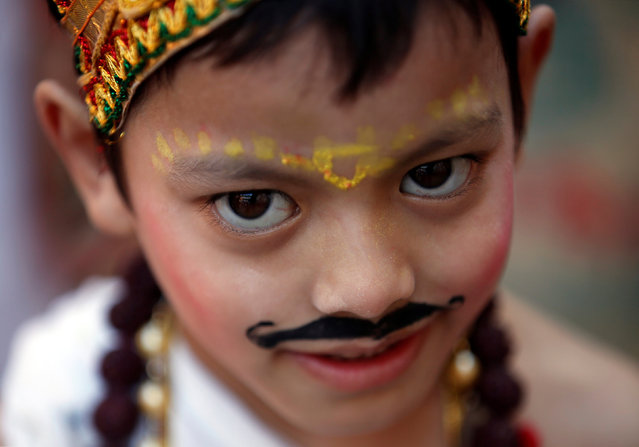 "A boy, dressed up as a holy man, takes part in a parade to mark the Gaijatra festival, also known as ""cow festival"", in Kathmandu, Nepal, August 19, 2016. (Photo by Navesh Chitrakar/Reuters)"