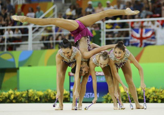 2016 Rio Olympics, Rhythmic Gymnastics, Preliminary, Group All-Around Qualification, Rotation 2, Rio Olympic Arena, Rio de Janeiro, Brazil on August 20, 2016. Team Uzbekistan (UZB) compete using clubs and hoops. (Photo by Mike Blake/Reuters)