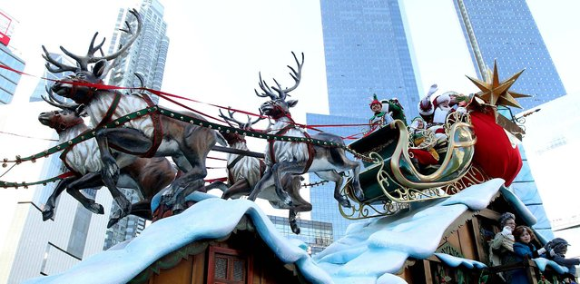 The Santa Claus float rounds Columbus Circle during the 86th Annual Macy's Thanksgiving Day Parade. (Photo by Tina Fineberg/Associated Press)