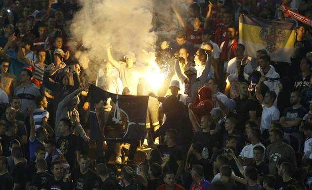 Fans of Serbia burn a NATO flag during their Euro 2016 Group I qualifying soccer match against Albania at the FK Partizan stadium in Belgrade October 14, 2014. (Photo by Marko Djurica/Reuters)