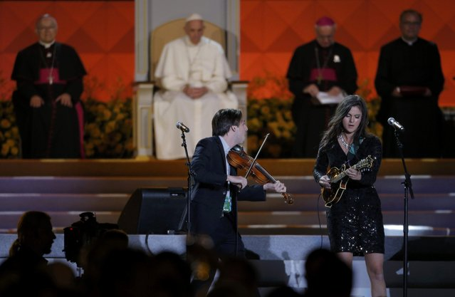 Marie Miller (R) performs for Pope Francis (rear, 2nd from L) as he attends the Festival of Families rally in Philadelphia, Pennsylvania September 26, 2015. (Photo by Brian Snyder/Reuters)