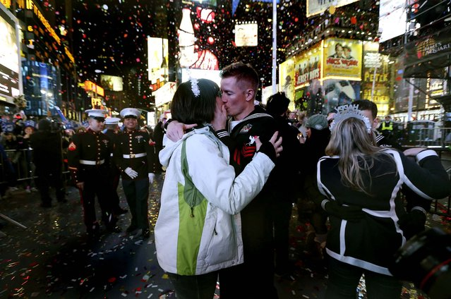 Revelers ring in the new year in New York's Times Square. (Photo by Michelle V. Agins/The New York Times)