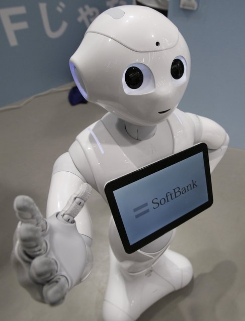 "SoftBank Corp's human-like robot named ""Pepper"" is displayed at its branch, in Tokyo, in this June 6, 2014 file photo. Nestle SA will enlist a thousand humanoid robots to help sell its coffee makers at electronics stores across Japan, becoming the first corporate customer for the chatty, bug-eyed androids unveiled in June by tech conglomerate SoftBank Corp. (Photo by Yuya Shino/Reuters)"