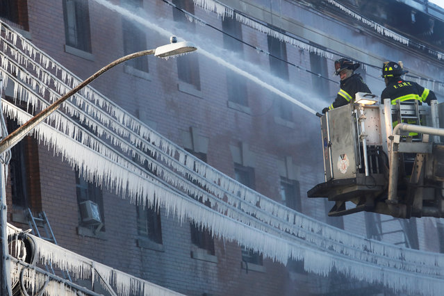 Fire Department of New York (FDNY) firemen work at an apartment building in the Bronx, New York, U.S. January 2, 2018. (Photo by Shannon Stapleton/Reuters)