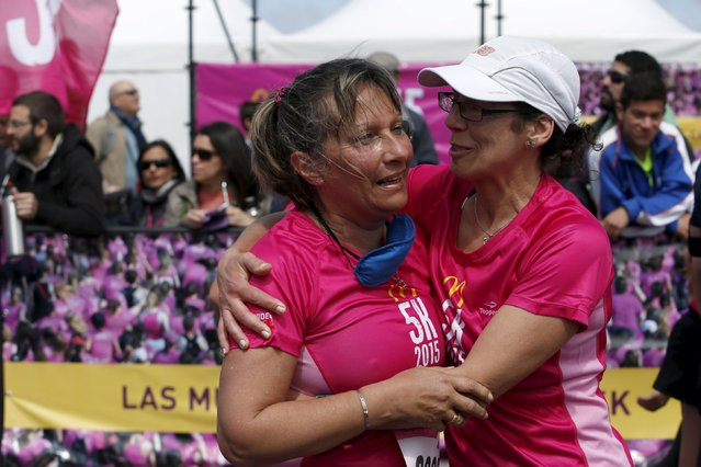 Laura Paipo (L), first blind principal in Uruguay embraces her sighted guide and friend Amparo Bauter after finishing a street race in Montevideo, October 4, 2015. (Photo by Andres Stapff/Reuters)