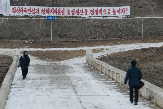 Residents walk through the snowy streets in February 2013, in Pyongyang, North Korea. (Photo by Andrew Macleod/Barcroft Media)