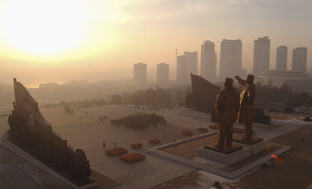 Statues of North Korea's founder Kim Il Sung and former leader Kim Jong Il at Mansudae hill in Pyongyang, North Korea on  January 1, 2014. (Photo by Reuters/KCNA)