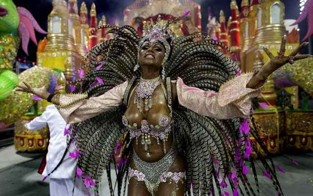 A dancer from the X-9 Paulistana samba school performs in Sao Paulo. (Photo by Andre Penner/Associated Press)