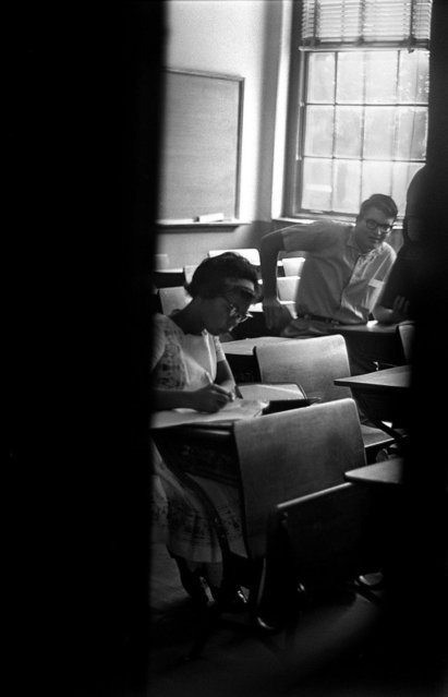 September 1963, Patricia Marcus, left, sits in a nearly abandoned classroom at West End High School in September 1963. Most of the school's student body boycotted Marcus' and Josephine Powell's integration of their school. (Photo by Robert Adams/The Birmingham News)