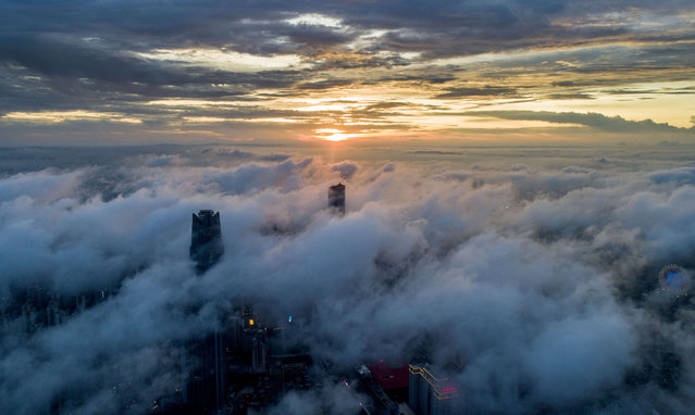 More than 300 meters tall buildings are hazy in the sunset cloud in Nanning, Guangxi province, China, on the evening of August 7, 2020. (Photo by Costfoto/Barcroft Media via Getty Images)