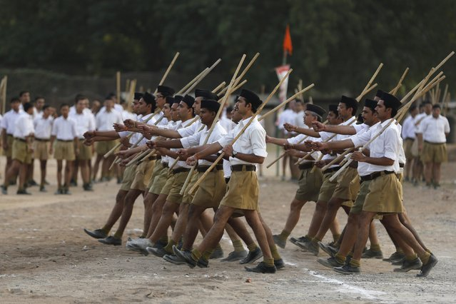 """Volunteers of the Hindu nationalist organisation Rashtriya Swayamsevak Sangh (RSS) take part in the """"Path-Sanchalan"""", or Volunteer March during celebrations to mark the Vijaya Dashmi or Dussehra in Ahmedabad, India, October 18, 2015. Effigies of the 10-headed demon king """"Ravana"""" are burnt on Dussehra, the Hindu festival that commemorates the triumph of Lord Rama over the Ravana, marking the victory of good over evil. Dussehra is on October 22. (Photo by Amit Dave/Reuters)"""